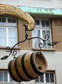 Hanging wine barrel against old building