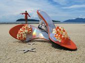 image of thumbelina  - Trandy shoes on the sand of Langkawi island - JPG
