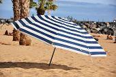 Striped umbrella on the beach