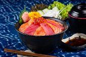 Tuna And Salmon Sashimi With Rice. poster