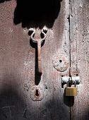 Door knocker with keyhole and padlock of a old door