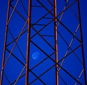 Nocturne with captive moon in a tower of high tension
