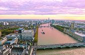 Purple Sunset Scenery Of London City United Kingdom - Thames River, Westminster Bridge And Houses Of poster