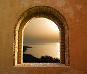 sunset on the sea through the windows