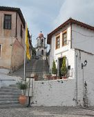 Постер, плакат: вид традиционных домов лестница и колокольня в старом городе Ксанти Греция