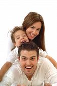 stock photo of happy family  - Excited happy young family in a joyful huddle - JPG