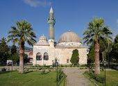 mosque with tiled minaret in a garden with palm trees of Iznik the ancient Byzantine city of Council