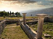sunset on the columns of episcopal complex in ancient city of Byllis, Albania