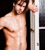 Man Confident Lover Near Door. Sexy Attractive Macho Tousled Hair Coming Out Through Bedroom Door. S poster