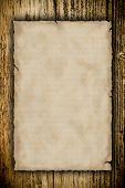 Grunge blank paper with wooden background