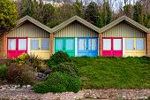 A Row Of Colorful Beach Huts On The South Devon Coast Near Exmouth, England poster