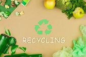 Green Recycle Arrow Sign As Symbol Of Sorting Of Used Trash Garbage As: Glasses, Paper, Food And Pla poster