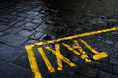 Taxi sign on rainy street
