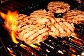 Hamburger patties on grill