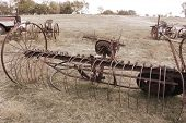 picture of horse plowing  - Antique farming equipment left on abandoned fields  - JPG