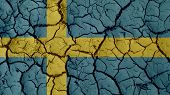 Political Crisis Or Environmental Concept: Mud Cracks With Sweden Flag poster