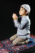 A little muslim praying