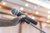 Speaker Holding Microphone For Speak, Presentation On Stage In Public Conference Seminar Room. Busin poster