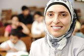 Muslim kids in the school, classroom with a teacher, smiling portrait