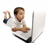 Child using a laptop and shocking