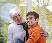 Muslim young woman with little cute boy
