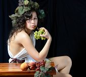 A female version of Bacchus, the roman god of the grape harvest.