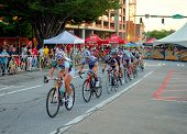 ATHENS, GEORGIA - MAY 30: Cyclists round a turn in Athens Twilight Criterium, the first nighttime ra