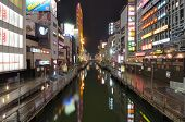 OSAKA, JAPAN - JULY 7: Dotonburi Canal is a manmade waterway dug in the early 1600's and now displays many landmark commercial locals and vivid neon signs on July 7, 2011 in Osaka, Japan.