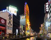 OSAKA, JAPAN - JULY 7: Dotonbori Canal is a manmade waterway dug in the early 1600's and now displays many landmark vivid neon signs July 7, 2011 in Osaka, Japan.