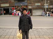 YANQING, CHINA - MARCH 22: Homeless man poses in Yanqing March 22, 2008 in Yanqing, China. Though poor, the county is popular for the Badaling section of the Great Wall and attracts many tourists.