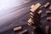 Wooden Building Blocks Tower On Wooden Background Top View With Copy Space. Wood Blocks Stack Game B poster