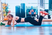 The Girl Is Engaged In Fitness And Does Exercise Plank During Training. Toned Image. Concept Of A He poster