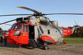 LEEUWARDEN,FRIESLAND,HOLLAND-SEPTEMBER 17: British Westland Sikorsky Sea King HU-5 helicopter  at the â??Luchtmachtdagenâ? Airshow  on September 17, 2011 at Leeuwarden Airfield,Friesland,Holland