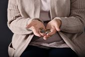 Poor Elderly Woman Holding Coins, Focus On Hands poster