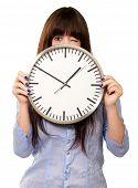 Woman Holding Clock Winking Isolated On White Background