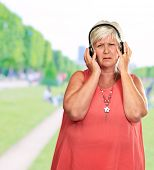 Portrait Of Senior Woman Listening Music, Selective
