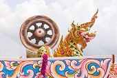 pic of annal  - The wheel of law and naga image in Buddhist - JPG
