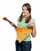 Beautiful teen girl with balalaika posing on white background
