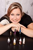 Woman Shows Her Collection Of E-cigarettes And Various Liquids