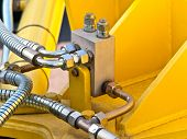 image of hydraulics  - photo of hydraulic tubes against yellow background - JPG