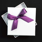 White Gift With Purple Ribbon