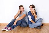 Young couple talking on mobile phone