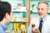 image of erectile dysfunction  -  Pharmacist dealing with a customer - JPG