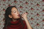 Woman With Lipstick With Floral Background