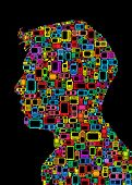 Profile silhouette of man made with Cellphones and Smartphones in black background