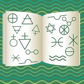 stock photo of arsenic  - book with alchemy symbols on wavy background - JPG