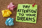 pay attention to your dreams - motivation or self improvement concept - handwriting on colorful stic