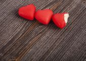 Two Love Heart Candies on crack break wood texture background, valentines day card concept