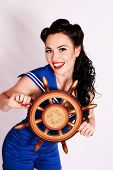 Sailor pin up girl with steering wheel.
