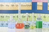 Laboratory glassware with chemical chart background